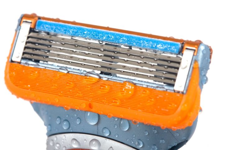 4474052 - razor cleaning with water drops on isolated